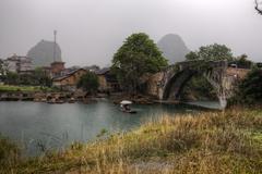 Dragon Bridge on Yulong River, Yangshuo, Guilin, Guangxi Province, China. - stock photo