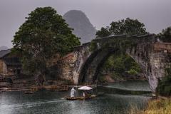 Dragon Bridge in Yulong Village, Yangshuo, Guilin, Guangxi Province, China. - stock photo