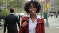 African American black woman in city walking happy smile face - stock footage