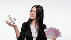 Business woman with euro money and a trolley in her hands Stock Footage