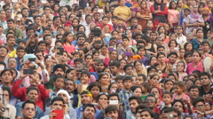 Colorful crowds use smartphones during Wagah ceremony in India Stock Footage