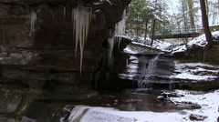 Waterfall underneath path in winter Stock Footage
