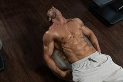 Exercising Abdominals On Exercise Ball Stock Photos