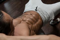 Exercising Abdominals On Exercise Ball - stock photo