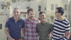 Group Of Friends Stand On A Rooftop, Smile And Laugh, Happy To Be Together (4K) Stock Footage