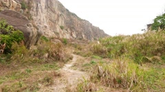 Walk on deserted rocky mountain foot, former stone quarry at Lei Yue Mun shore Stock Footage