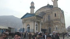 Kabul downtown the old city mosque with pigeons Stock Footage