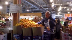 Customer buying fruit at Chinese Supermarket - stock footage