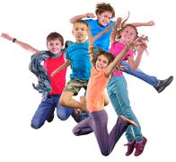 Happy dancing jumping children isolated over white background Stock Photos
