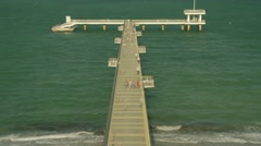 shadow spread on marine pier people walking hurriedly-timelapse - stock footage