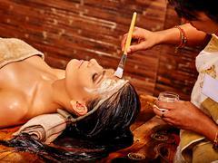 Woman having mask at ayurveda spa - stock photo