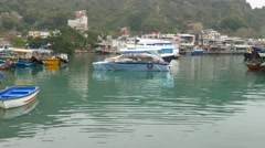Boats on beautiful colored waters of typhoon shelter in Lei Yue Mun Stock Footage