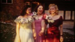 2045 - young girls dressed for the prom, one dances - vintage film home movie Stock Footage