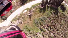 Aerial riding the cable car from Mount of Temptation to Jericho Stock Footage