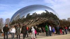 Crowd tourists at the Cloud Gate sculpture in the Millennium Park. Time lapse Stock Footage