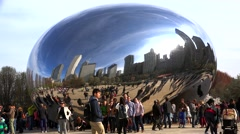 Crowd tourists at the Cloud Gate sculpture in the Millennium Park. Stock Footage