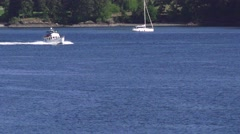 Yacht cruising the inside passage islands past sailboat Stock Footage