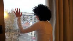 4k Desparate sad girl farewell near window thinking about something. UHD focu - stock footage