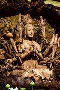 Guan Yin wood carving - stock photo