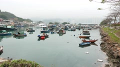 Boats diversity on typhoon shelter in Lei Yue Mun. Panoramic shot, moving camera Stock Footage