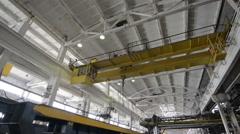 Bridge crane rides on factory floor Stock Footage