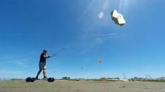Landind kite and kite buggy in action Stock Footage