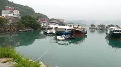 Big boats on calm beautiful water of Sam Ka Tsuen Typhoon Shelter Stock Footage
