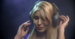 Pretty young girl with headphones and sunglasses dancing Stock Footage