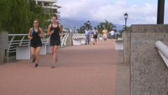 Joggers on the Malecon (Broadwalk) in Puerto Vallarta, Mexico - stock footage