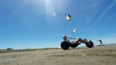 Kite buggy and landking kite in action - stock footage