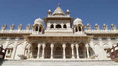 Facade of Jaswant Thada temple, with people passing aside. Stock Footage