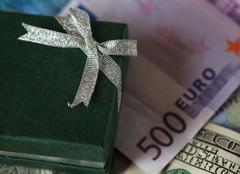 present box and money - dollar and euro - stock photo