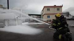 Firefighters with protective gear practice leak of chemicals Stock Footage