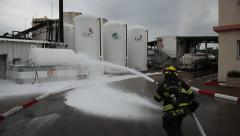 Firefighters with protective gear practice leak of chemicals - stock footage