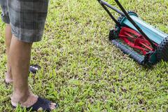 man using lawn mower - stock photo