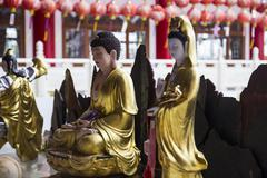 buddha and goddess of mercy statue - stock photo