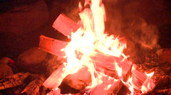 Elegant campfire- fire ring surrounded by stones Stock Footage