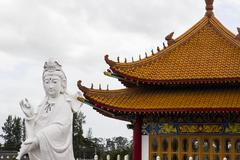 compassion and mercy goddess statue and pavilion - stock photo