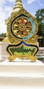 Buddhist wheel symbol boundary markers around the church Stock Photos