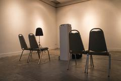 Chair and projector Stock Photos