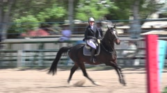 Jumping horse through barrier on equestrian competitions at arena Stock Footage