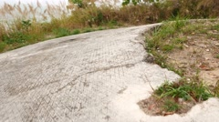 Close up view on former military battery ruins, deserted grassy construction Stock Footage