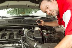 A Mechanic Checking The Brake Fluis Levels In A Car Stock Photos