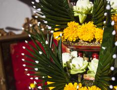 lotus, marigold and folded banana leaf ornament - stock photo