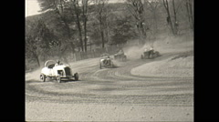 Vintage 16mm film, 1948, early stock car race, into the front straight Stock Footage