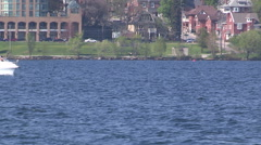 Stock Video Footage of Various boats out on the lake in choppy waters on windy day