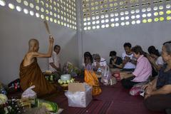 Buddhist monk is blessing people who make a great merit Stock Photos