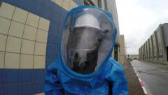Firefighters with protective gear practice leak of Ammonia chemical - stock footage