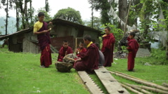 Buddhist monks play drums outside temple, medium long shot, shallow DOF Stock Footage