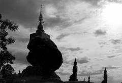 angel statue worshiping buddha pagoda - stock photo